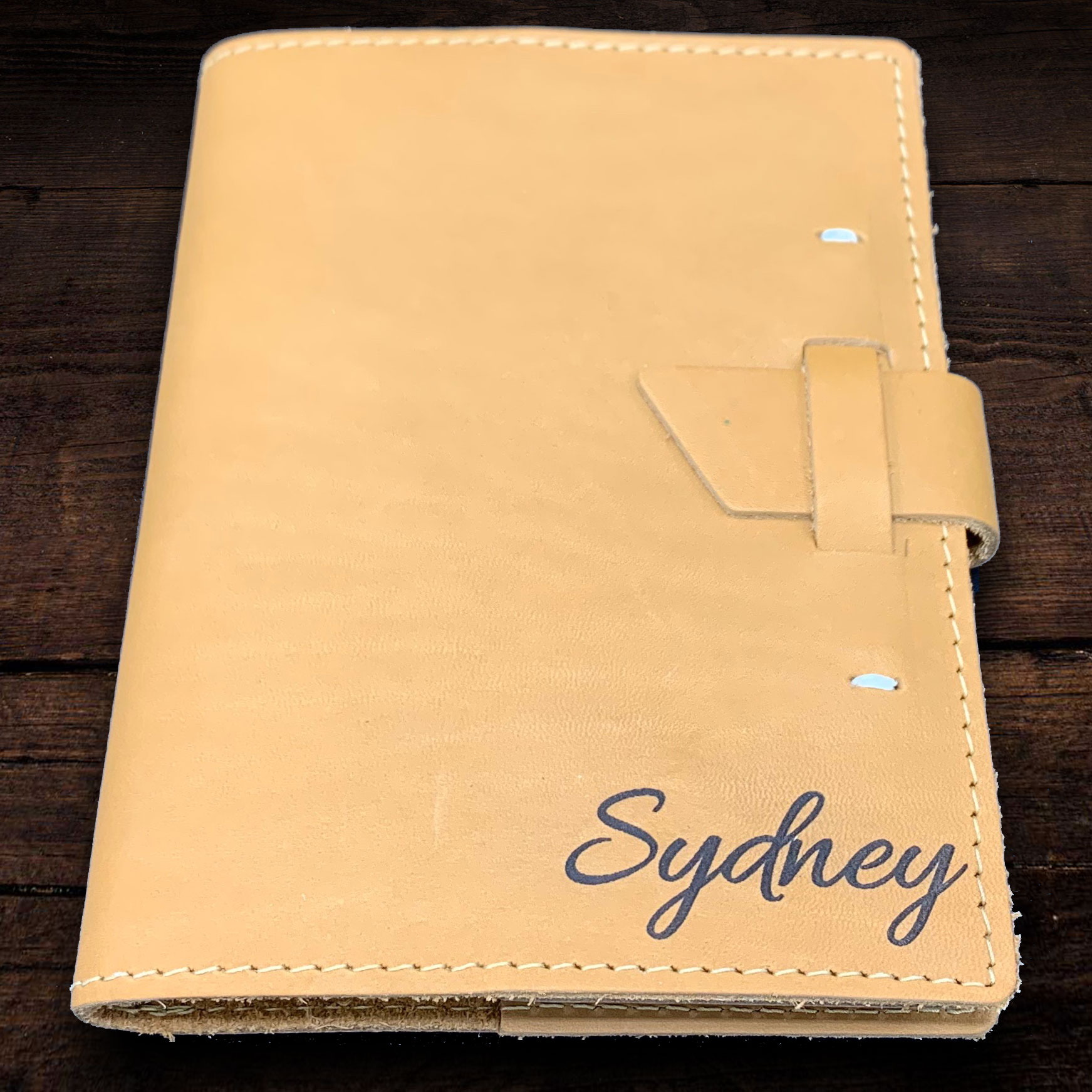 The perfect gift, journal, or professional notebook, this handcrafted notebook features top-grain le