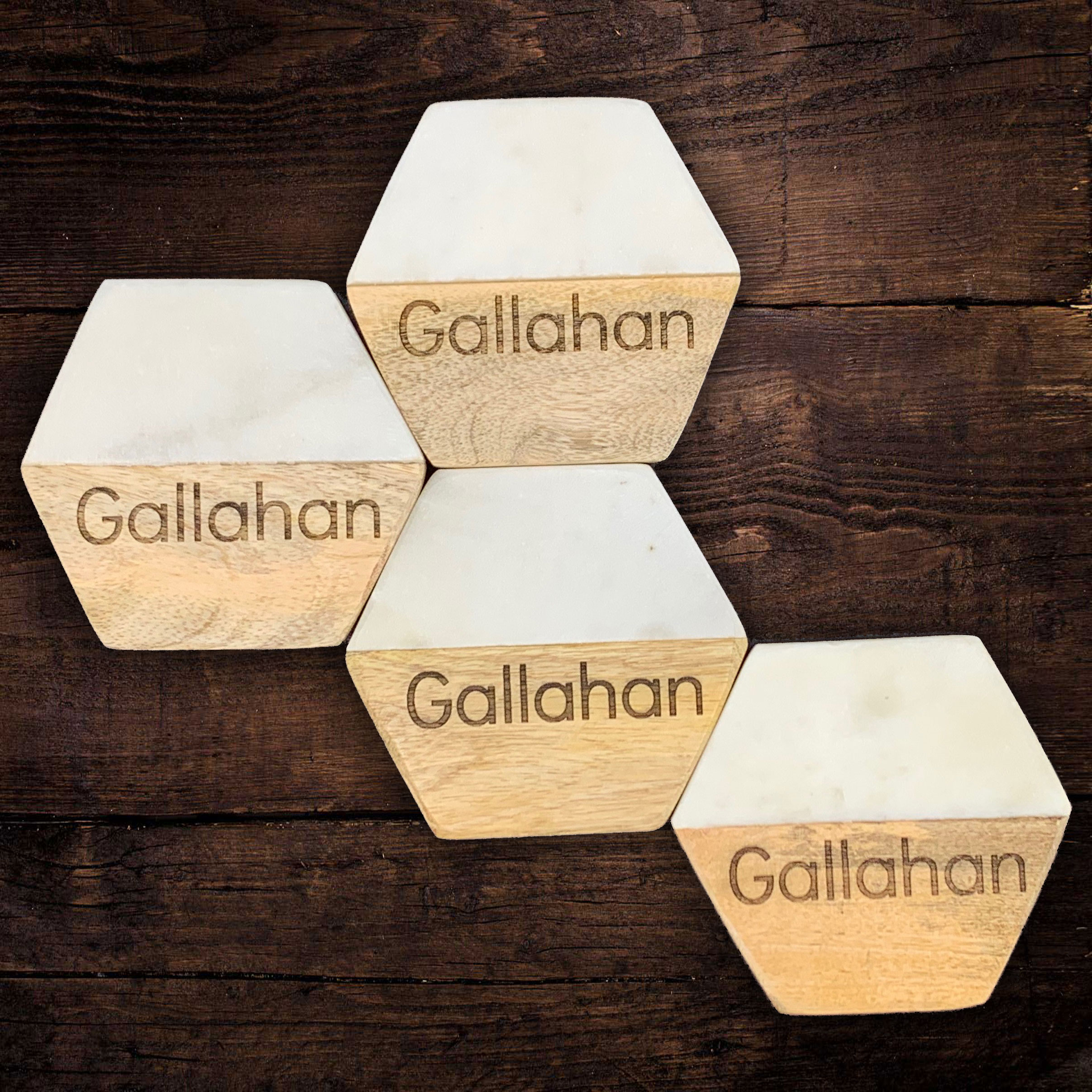 A personalized set of 4 marble and mango wood hexagon shaped coasters makes a special gift with a pe