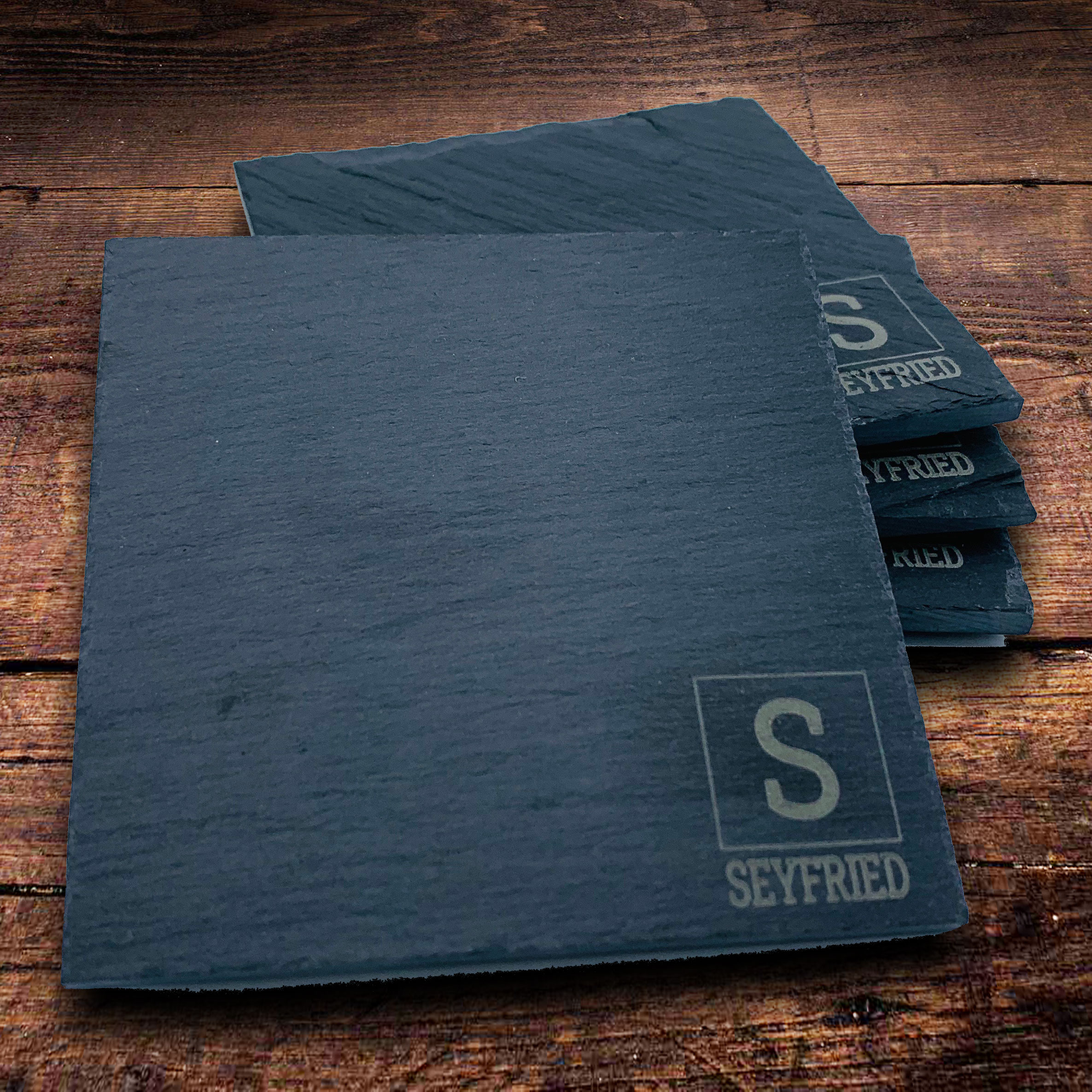 Personalized custom engraved slate coasters make a perfect gift families will remember you by.
