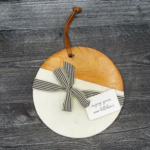 The White Marble Round Wood Cutting Board caters to all your culinary needs. This circular piece is