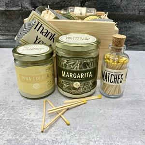 Nothing smells more like relaxation in a glass jar than the Margarita and Pina Colada candles hand-p