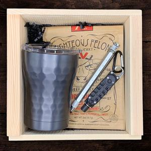 The Bro Box is perfect for the gadget lover. The sleek stainless steel black dimpled tumbler will ho
