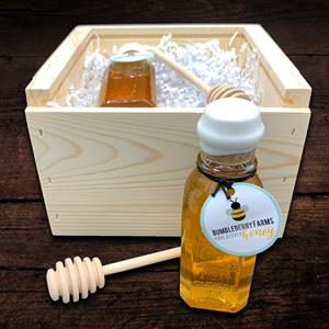 This gift box contains an 8 ounce jar of pure clover honey bottled in corked glass jars reproduced f