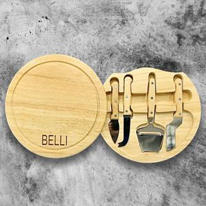 Circular cheese/meat cutting board doubles as a storage compartment for three stainless steel tools